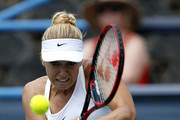 Sabine Lisicki of Germany returns a shot to Kristina Mladenovic of France during day 4 of the Citi Open at Rock Creek Tennis Center on July 21, 2016 in Washington, DC.