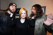 Singers & Songwriters Randy Houser, Kellie Pickler and Jamey Johnson pose for photographs backstage during the CMT Tour at the Wildhorse Saloon on December 8, 2009 in Nashville, Tennessee.