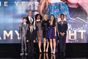 (L-R) Campbell Remess, Anderson Cooper, Ryan Hickman, Haile Thomas, Christina Li, and Sidney Keys III pose onstage during CNN Heroes 2017 at the American Museum of Natural History on December 17, 2017 in New York City. 27437_017