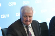In this image shot through a pain of glass Horst Seehofer, Chairman of the Bavarian Social Union (CSU), arrives for a meeting of the CSU leadership at party headquarters on October 15, 2018 in Munich, Germany. The CSU faired poorly in the election, winning 37.2% of the vote, 10.5 votes fewer than in the last election. The CSU has long been Bavaria's strongest party but will now face the arduous task of forming a state government coalition.