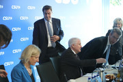 In this image shot through a pain of glass Horst Seehofer (C, seated), Chairman of the Bavarian Social Union (CSU), and Markus Soeder (C, standing), Governor of Bavaria and lead candidate of the CSU in yesterday's Bavarian state elections, arrive for a meeting of the CSU leadership at party headquarters on October 15, 2018 in Munich, Germany. The CSU faired poorly in the election, winning 37.2% of the vote, 10.5 votes fewer than in the last election. The CSU has long been Bavaria's strongest party but will now face the arduous task of forming a state government coalition.