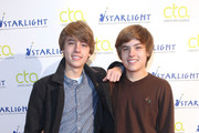 (l-r) Actors Cole Sprouse and Dylan Sprouse arrive to teach a Master Workshop on acting, hosted by Celebrity Talent Academy and Starlight Children's Foundation at the Cochrane Theatre on  January 29, 2011 in London, England.