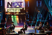 """Mentors John Rich, Joe Jonas, Nelly and Gloria Estefan look into the crowd during a live taping of CW's """"The Next"""" on August 7, 2012 in Dallas, Texas."""