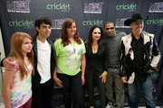 Joe Jonas (2L) , Gloria Estefan (4L), Nelly (5L) and John Rich (R) pose for a portrait with fans before a live taping of CW's 'The Next' on August 7, 2012 in Dallas, Texas.