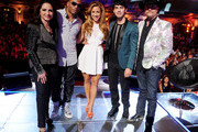 "(L-R) Singers/mentors Gloria Estefan, Nelly, host Allison Hagendorf, singers/mentors Joe Jonas and John Rich pose onstage at a taping of The CW's ""The Next"" at the Orpheum Theatre on August 15, 2012 in Los Angeles, California."