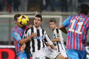 Mariano Izco (L) of Catania competes for the ball with Andrea Lazzari of Udinese during the Serie A match between Calcio Catania and Udinese Calcio at Stadio Angelo Massimino on November 9, 2013 in Catania, Italy.