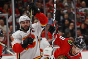 Mark Giordano #5 of the Calgary Flames and Nick Schmaltz #8 of the Chicago Blackhawks battle for position at the United Center on February 6 2018 in Chicago, Illinois. The Flames defeated the Blackhawks 3-2.