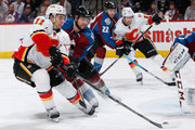 Mikael Backlund #11 of the Calgary Flames earns an assist as he has his shot deflected by goalie Semyon Varlamov #1 of the Colorado Avalanche as David Jones #19 of the Calgary Flames collects the puck to score as Jan Hejda #8 and Zach Redmond #22 of the Colorado Avalanche defend and the Avalanche hold a 2-1 lead in the third period at Pepsi Center on March 14, 2015 in Denver, Colorado. The Avalanche defeated the Flames 3-2.