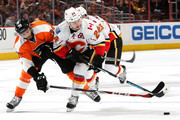 Jiri Hudler #24 of the Calgary Flames and Pierre-Edouard Bellemare #78 of the Philadelphia Flyers battle for the puck at Wells Fargo Center on March 3, 2015 in Philadelphia, Pennsylvania. The Calgary Flames won, 3-2, in overtime.