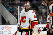 Mike Smith #41 of the Calgary Flames talks to a referee during their preseason game against the San Jose Sharks at SAP Center on September 27, 2018 in San Jose, California.