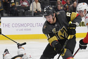 Jonathan Marchessault #81 of the Vegas Golden Knights skates with the puck as Mark Giordano #5 of the Calgary Flames dives to defend in the second period of their game at T-Mobile Arena on February 21, 2018 in Las Vegas, Nevada.