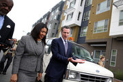 California Lt. Gov. and California gubernatorial candidate Gavin Newsom (R) talks with San Francisco mayor London Breed (L) as they visit the Alice Griffith Apartments on August 22, 2018 in San Francisco, California. Lt. Gov. Gavin Newsom and San Francisco mayor London Breed toured a low-income housing complex. Newsom leads Republican gubernatorial candidate John Cox by an average of 23 percentage points in recent polls.