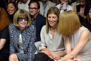 Vogue editor-in-chief Anna Wintour (L) and Vogue's fashion market / accessories director Virginia Smith (C) attend the Calvin Klein Collection fashion show during Mercedes-Benz Fashion Week Spring 2014 at Spring Studios on September 12, 2013 in New York City.