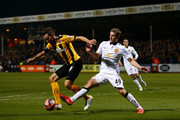 Tom Champion of Cambridge United battles for the ball with James Wilson of Manchester United during the FA Cup Fourth Round match between Cambridge United and Manchester United at The R Costings Abbey Stadium on January 23, 2015 in Cambridge, England.