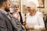 Waqas Khan, son Sami Khan and mum Madia Rahim meet Camilla, Duchess of Cornwall  during a reception at Clarence House hosted by the Duchess of Cornwall, for youngsters and their carers from Helen and Douglas House on December 11, 2013 in London, England.