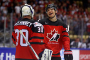 Curtis McElhinney, goaltender of Canada celebrate with team mate Colton Parayki after the 2018 IIHF Ice Hockey World Championship group stage game between Canada and Denmark at Jyske Bank Boxen on May 7, 2018 in Herning, Denmark.