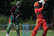 Ashish Bagai of Canada in action as Maurice Ouma of Kenya watches during the ICC World Cricket League Division One match between Canada and Kenya at the Excelsior Cricket Club on July 9, 2010 in Schiedam, Netherlands.
