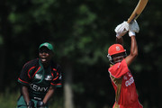 Nitish Kumar of Canada in action as Maurice Ouma of Kenya watches during the ICC World Cricket League Division One match between Canada and Kenya at the Excelsior Cricket Club on July 9, 2010 in Schiedam, Netherlands.