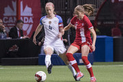 Becky Sauerbrunn #4 of the United States passes the ball while pressured by Janine Beckie #16 of Canada during International Friendly soccer match action at BC Place on November 9, 2017 in Vancouver, Canada.