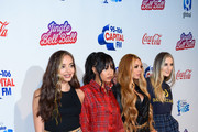 Jade Thirlwall, Leigh-Anne Pinnock, Jesy Nelson and Perrie Edwards of Little Mix attend the Capital FM Jingle Bell Ball at The O2 Arena on December 09, 2018 in London, England.