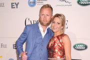 Ice hockey player Valeri Bure (L) and actress Candace Cameron-Bure attend the Capitol File's WHCD Welcome Reception at British Ambassador's Residence on April 29, 2016 in Washington, DC.