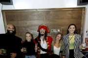 Carlos Boozer, Rachel Demita, Lauren Sesselmann, and Stefanie Dolson pose for a photo during the Captain Morgan Pose-Off Challenge at Palmer's Bar on April 7, 2019 in Minneapolis, Minnesota.