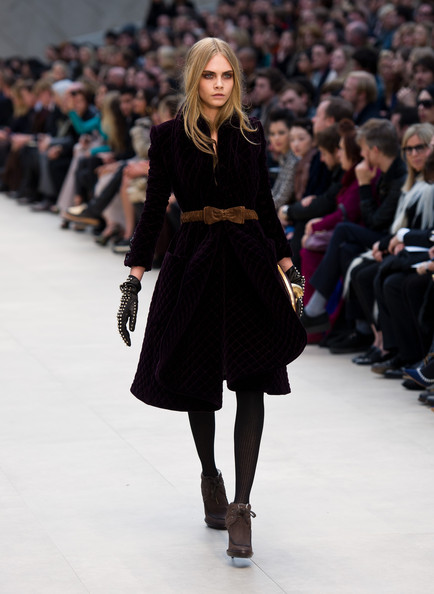 Cara Delevingne Cara Delevingne walks the runway during the Burberry Prorsum show at London Fashion Week Autumn/Winter 2012 at Kensington Gardens on February 20, 2012 in London, England.