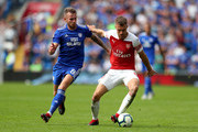 Aaron Ramsey of Arsenal holds off Joe Ralls of Cardiff City during the Premier League match between Cardiff City and Arsenal FC at Cardiff City Stadium on September 2, 2018 in Cardiff, United Kingdom.