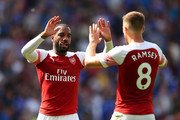 Alexandre Lacazette and Aaron Ramsey of Arsenal celebrate victory after the Premier League match between Cardiff City and Arsenal FC at Cardiff City Stadium on September 2, 2018 in Cardiff, United Kingdom.