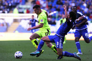 Fabio of Cardiff City challenges for the ball with Harry Bunn of Huddersfield during the Sky Bet Championship match between Cardiff City and Huddersfield at Cardiff City Stadium on September 12, 2015 in Cardiff, Wales.