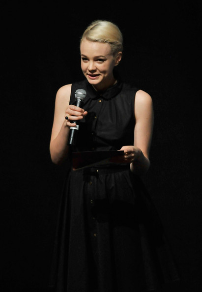 "Carey Mulligan Actress Carey Mulligan speaks onstage as she presents actor Colin Firth with his Variety ""International Star of the Year"" Award during day two of the 7th Annual Dubai International Film Festival held at the Madinat Jumeriah Complex on December 13, 2010 in Dubai, United Arab Emirates."