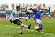 Aaron Lennon of Everton is closed down by Mark Ellis of Carlisle United during the Emirates FA Cup Fourth Round match between Carlisle United and Everton at Brunton Park on January 31, 2016 in Carlisle, England.