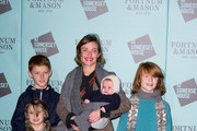 Camilla Rutherford (C) pose with her children Hector, Maud, Nancy and new baby Blaise at the launch of 'Skate @ Somerset House' at Somerset House on November 17, 2015 in London, England.