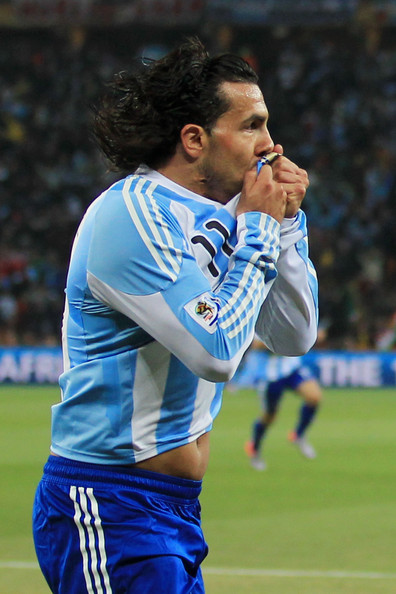 Argentina v Mexico: 2010 FIFA World Cup - Round of Sixteen [sports,team sport,ball game,player,football player,sports equipment,soccer,sport venue,football,soccer player,sixteen,carlos tevez,goal,mexico,soccer city stadium,south africa,johannesburg,argentina,2010 fifa world cup,match]
