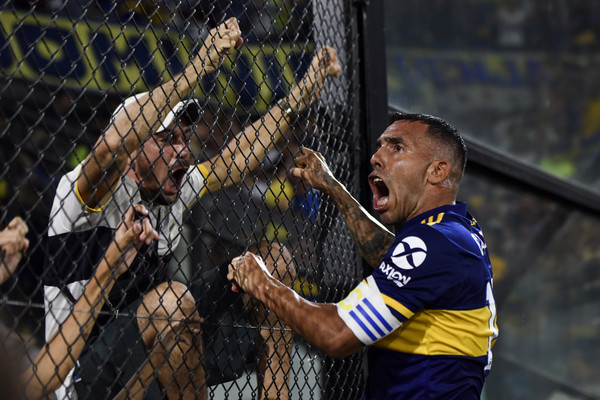 Global Sports Pictures of the Week - March 09 [global sports pictures of the week,boca juniors celebrates after scoring the first goal of his team with fans during,player,net,team sport,sports,sports equipment,ball game,competition event,sport venue,championship,team,carlos tevez,march,argentine primera divisi\u00f3n,buenos aires,argentina,club de gimnasia y esgrima la plata,boca juniors,gimnasia as part of superliga 2019/20 at estadio alberto j. armando on march,carlos tevez,boca juniors,2019\u201320 argentine primera divisi\u00f3n,estadio alberto j. armando,club atl\u00e9tico river plate,club de gimnasia y esgrima la plata,supercopa argentina,goal,superliga argentina]