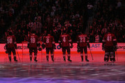 (L-R) Antoine Vermette #50, Shane Doan #19, Tobias Rieder #8, Zbynek Michalek #4, Oliver Ekman-Larsson #23 and goaltender Mike Smith #41 of the Arizona Coyotes stand attended before the NHL game against the Carolina Hurricanes at Gila River Arena on February 5, 2015 in Glendale, Arizona.