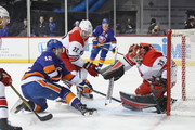 Brett Pesce #22 and Scott Darling #33 of the Carolina Hurricanes defend the net against Josh Bailey #12 of the New York Islanders during the second period at the Barclays Center on March 18, 2018 in the Brooklyn borough of New York City.
