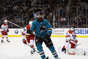 Brent Burns #88 of the San Jose Sharks celebrates after he scored the game-winning goal on Cam Ward #30 of the Carolina Hurricanes in overtime at SAP Center on December 7, 2017 in San Jose, California.  (Photo by Ezra Shaw/Getty Images) *** Local Caption *** Brent Burns; Cam Ward