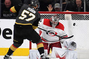 David Perron #57 of the Vegas Golden Knights misses a shot against Cam Ward #30 of the Carolina Hurricanes during a shootout in their game at T-Mobile Arena on December 12, 2017 in Las Vegas, Nevada. The Hurricanes won 3-2 in a shootout.