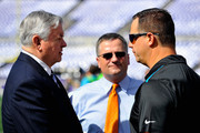 Carolina Panthers owner Jerry Richardson (L) talks before a game against the Baltimore Ravens at M&T Bank Stadium on September 28, 2014 in Baltimore, Maryland.