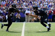 Quarterback Joe Flacco #5 of the Baltimore Ravens hands off to running back Justin Forsett #29 during the first half of a game against the Carolina Panthers at M&T Bank Stadium on September 28, 2014 in Baltimore, Maryland.
