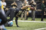 Jimmy Graham #80 of the New Orleans Saints reaches the ball out for a touchdown against the Carolina Panthers at Mercedes-Benz Superdome on December 8, 2013 in New Orleans, Louisiana.  The Saints defeated the Panthers 31-13.