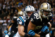 Jimmy Graham #80 of the New Orleans Saints is tackled as he scores a touchdown by  Luke Kuechly #59 of the Carolina Panthers at Mercedes-Benz Superdome on December 8, 2013 in New Orleans, Louisiana.