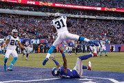Charles Tillman #31 of the Carolina Panthers intercepts a ball intended for Hakeem Nicks #88 of the New York Giants in the fourth quarter during their game at MetLife Stadium on December 20, 2015 in East Rutherford, New Jersey.