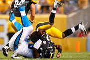 Michael Vick #2 of the Pittsburgh Steelers is tackled by Kawann Short #99 of the Carolina Panthers in the first quarter during the game at Heinz Field on September 3, 2015 in Pittsburgh, Pennsylvania.