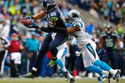 Jimmy Graham #88 of the Seattle Seahawks makes a catch against Roman Harper #41 of the Carolina Panthers at CenturyLink Field on October 18, 2015 in Seattle, Washington.