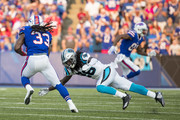 Donte Jackson #26 of the Carolina Panthers tackles Chris Ivory #33 of the Buffalo Bills during the first quarter of a preseason game at New Era Field on August 9, 2018 in Orchard Park, New York.