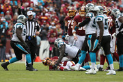 Quarterback Alex Smith #11 of the Washington Redskins lies on the field after being sacked in the second quarter against the Carolina Panthers at FedExField on October 14, 2018 in Landover, Maryland.