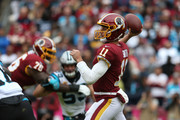 Quarterback Alex Smith #11 of the Washington Redskins throws the ball in the second quarter against the Carolina Panthers at FedExField on October 14, 2018 in Landover, Maryland.