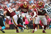 Running back Adrian Peterson #26 of the Washington Redskins rushes against the Carolina Panthers during the second half at FedExField on October 14, 2018 in Landover, Maryland.